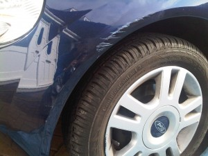 Scuffed wheel arch on Ford KA
