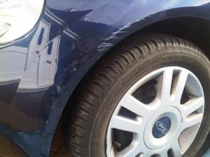 Scuffed wheel arch on Ford KA